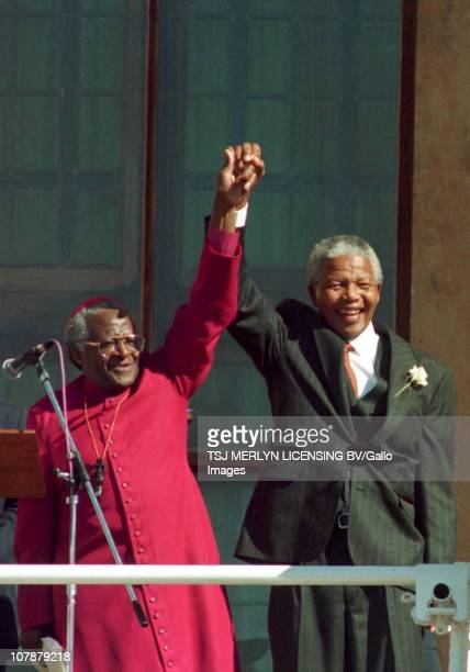 Archbishop Desmond Tutu introduces Nelson Mandela to the crowd at the City Hall Cape Town after he was elected State President