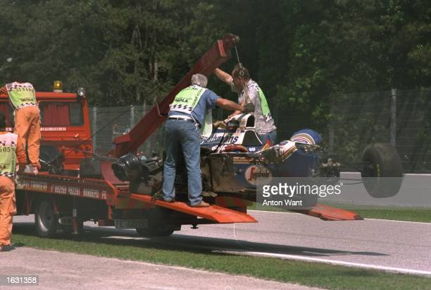 Ayrton Senna's Williams Renault is hauled off the circuit after Senna crashed during the San Marino Grand Prix at the Imola circuit in San Marino...