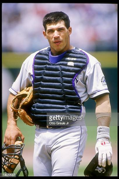 Catcher Joe Girardi of the Colorado Rockies stands on the field during a game against the San Francisco Giants at Candlestick Park in San Francisco...