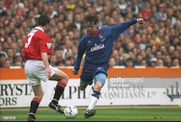 Denis Irwin of Manchester United tries to block the shot of Craig Burley of Chelsea during the FA Cup Final at Wembley Stadium in London Manchester...