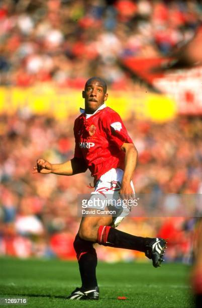 Dion Dublin of Manchester United keeps an eye on the ball during an FA Carling Premiership match against Coventry City at Old Trafford in Manchester...