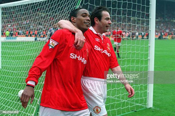 14 May 1994 FA Cup Final Chelsea v Manchester United Paul Ince of United is hugged by goalscorer Brian McClair after assisting with the fourth United...
