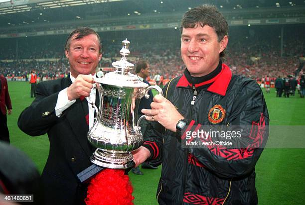 14 May 1994 FA Cup Final Manchester United v Chelsea United manager and assistant coach Alex Ferguson and Brian Kidd celebrate with the cup