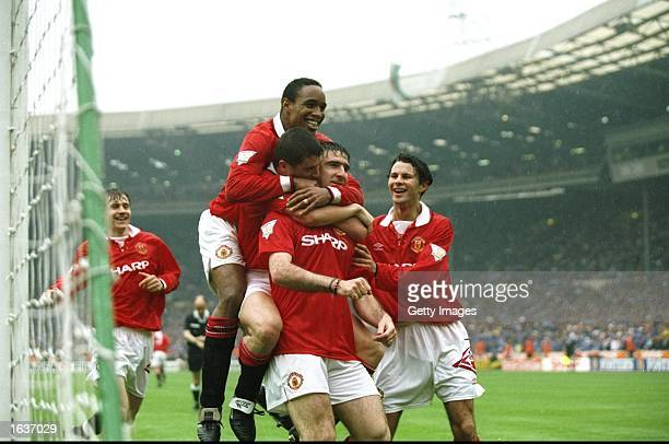 Manchester United players celebrate the penalty scored by Eric Cantona during the FA Cup Final against Chelsea at Wembley Stadium in London...