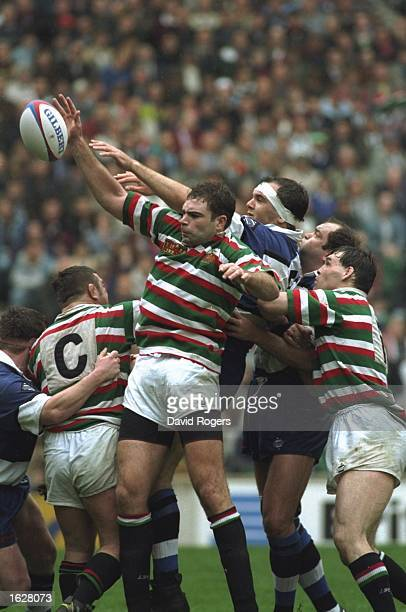 Matt Poole of Leicester and Andy Reed of Bath both stretch for the ball during the Pilkington Cup final at Twickenham in London. Bath won the final...