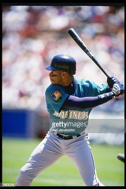 Outfielder Ken Griffey Jr of the Seattle Mariners swings his bat during a game against the Oakland Athletics at Oakland Alameda County Coliseum in...