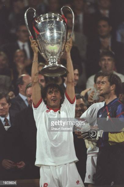 Paolo Maldini of AC Milan holds the trophy aloft after the European Cup final against Barcelona at the Olympic Stadium in Athens Greece AC Milan won...