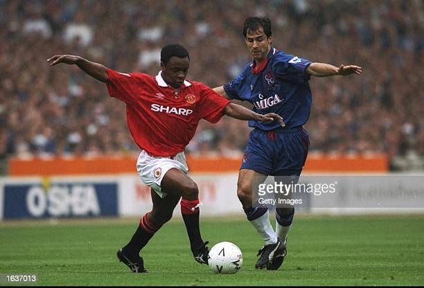 Paul Parker of Manchester United evades a tackle by Gavin Peacock of Chelsea during the FA Cup Final at Wembley Stadium in London Manchester United...