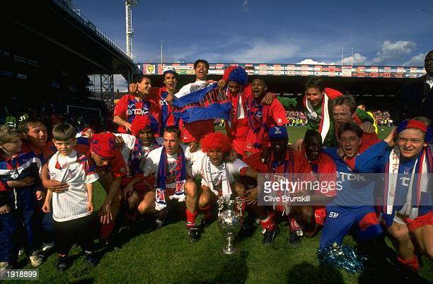 The Crystal Palace team with their trophy celebrate after they become First Division Champions after the match against Watford at Crystal Palace in...
