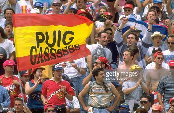 Alberto Puig fans celebrate his victory during the Spanish Grand Prix at the Jerez circuit in Spain Mandatory Credit Mike Cooper/Allsport