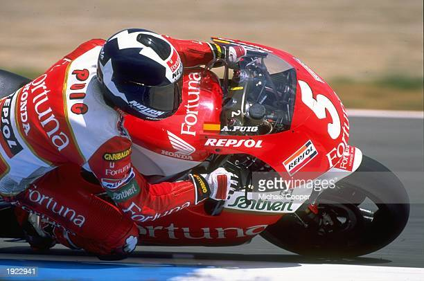 Alberto Puig of Spain leans into a corner on his Honda during the Spanish Grand Prix at the Jerez circuit in Spain Puig finished in first place...