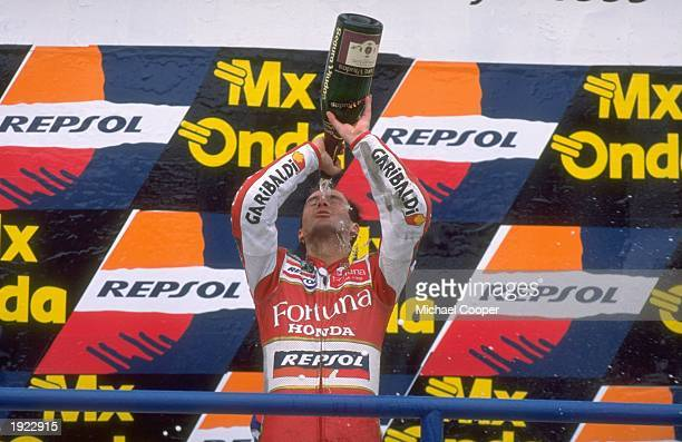 Alberto Puig of Spain pours champagne over his head after his victory in the Spanish Grand Prix at the Jerez circuit in Spain Mandatory Credit Mike...