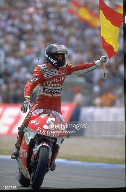 Alberto Puig of Spain stands on the pegs of his Honda after his victory in the Spanish Grand Prix at the Jerez circuit in Spain Mandatory Credit Mike...
