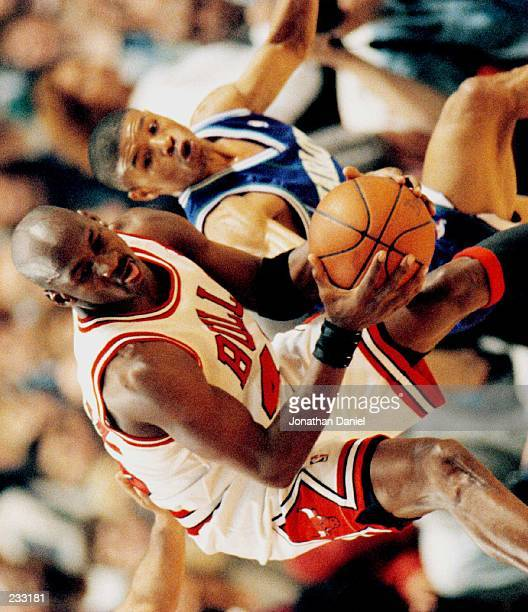Mugsy Bogues of the Charlotte Hornets battles Michael Jordan of the Chicago Bulls during the first half of Game 4 of the NBA first round playoffs at...