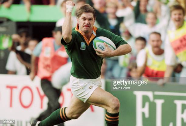 Pieter Hendriks of South Africa raises a clenched fist as he approaches the try line during the Rugby World Cup match against Australia played at...