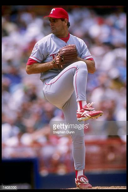 Pitcher Kenny Rogers of the Texas Rangers prepares to throw the ball during a game against the California Angels at Anaheim Stadium in Anaheim,...