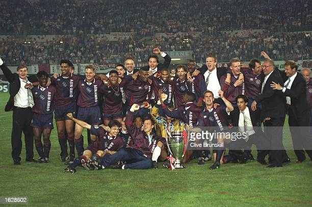The Ajax team celebrate with the trophy after their victory in the European Cup Final against AC Milan in Vienna Austria Ajax won the match 10...