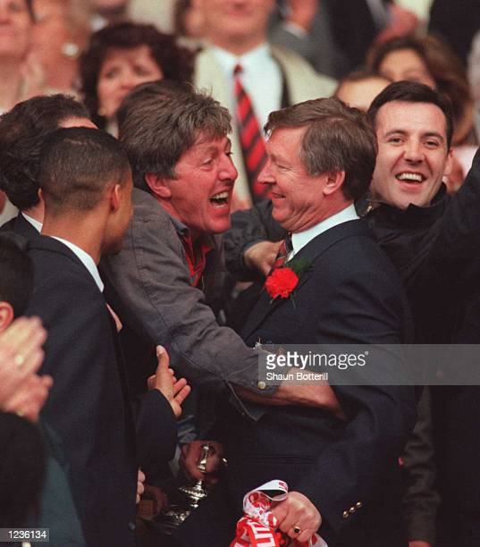 Alex Ferguson is jostled by fans as he comes down the steps with the trophy after Man Utd's victory over Liverpool in the 1996 FA Cup Final between...