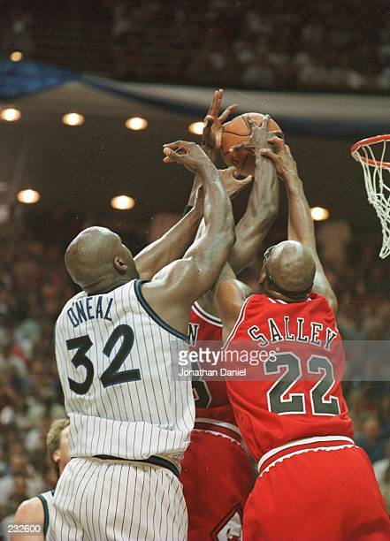 Center Shaquille O''Neal of the Orlando Magic Center John Salley and Scottie Pippen all go up for a rebound during the Bulls 8667 win in game 3 of...