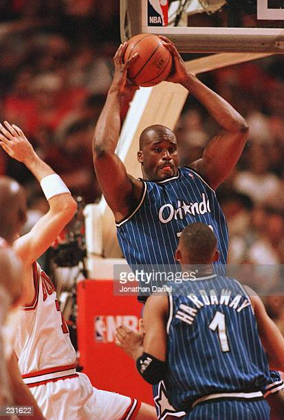 Center Shaquille O''Neal of the Orlando Magic pulls down a rebound during the fourth quarter of game one of the Eastern Conference Championships...