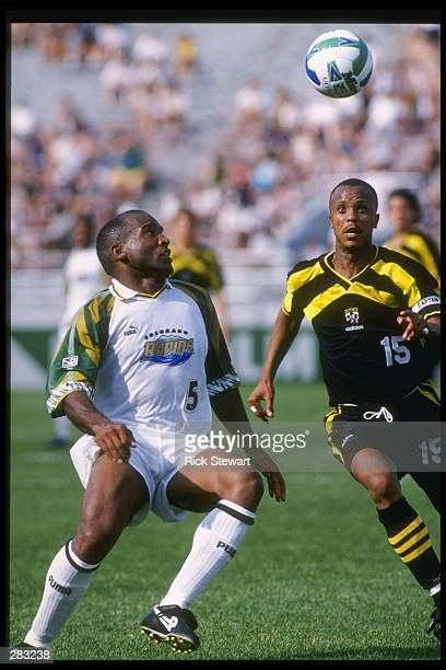 Denis Hamlett of the Colorado Rapids and Columbus Crew player Doctor Khumalo fight for the ball during a game at Ohio Stadium in Columbus Ohio The...