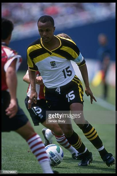 Doctor Khumalo of the Columbus Crew moves the ball against the Dallas Burn during an MLS game played at the Cotton Bowl in Dallas Texas The Burn won...