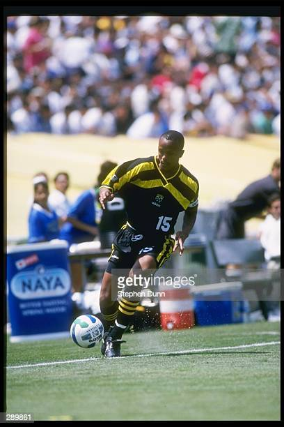 Doctor Khumalo of the Columbus Crew runs down the field with the ball during a game against the Los Angeles Galaxy at the Rose Bowl in Pasadena...
