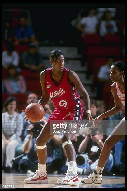 Forward Lisa Leslie of the United States dribbles in front of a Cuban player in a game played at the Providence Civic Center in Providence, Rhode...