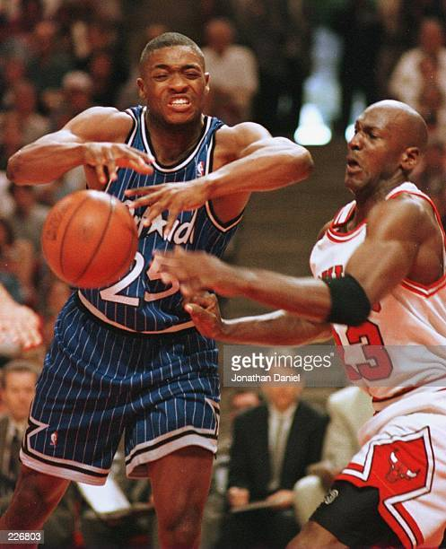 Forward Michael Jordan of the Chicago Bulls knocks the ball out of the hands of forward Nick Anderson of the Orlando Magic during first quarter...