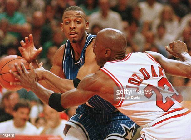 Forward Michael Jordan of the Chicago Bulls knocks the ball out of the hands of guard Anfernee ''Penny'' Hardaway of the Orlando Magic during second...