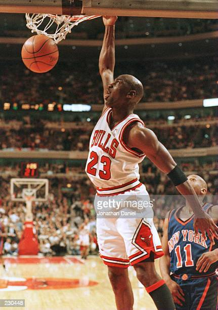 Guard Michael Jordan of the Chicago Bulls focuses on the rim following a slam dunk in the second quarter of the Bulls game five match up against the...