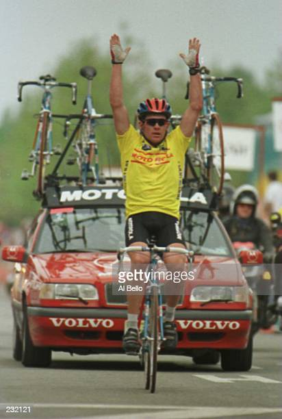 Lance Armstrong of team Motorola raises his arms in celebration as he crosses the finish line in victory to win stage six of the Tour DuPont in...