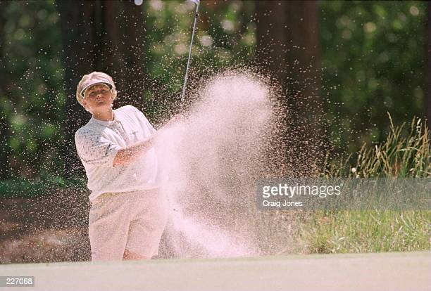 Laura Davies of England chips out of the sand on the 3rd hole during the first round of the US Women''s Open Championship at the Pine Needles Lodge...