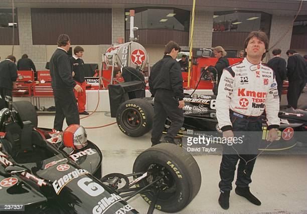 Michael Andretti keeps a watchful eye on the weather as his team prepares his Lola Ford T96/00 during practice for the inaugural US 500 round six of...