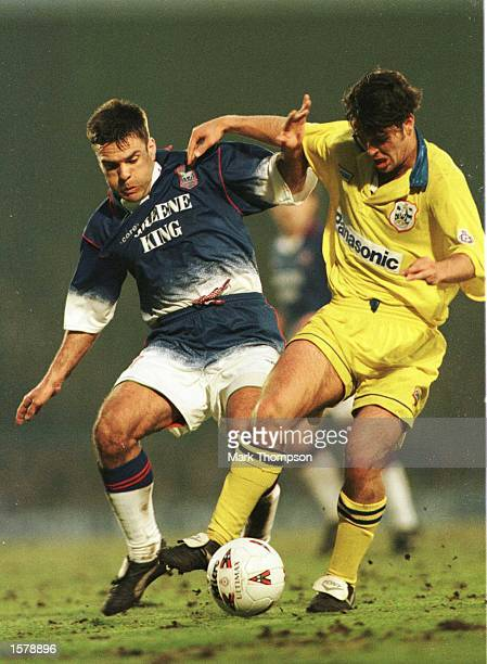 Mick Stockwell of Ipswich Town battles with Ben Thornley of Huddersfield during the Endsleigh League Division One game at Portman Road Mandatory...