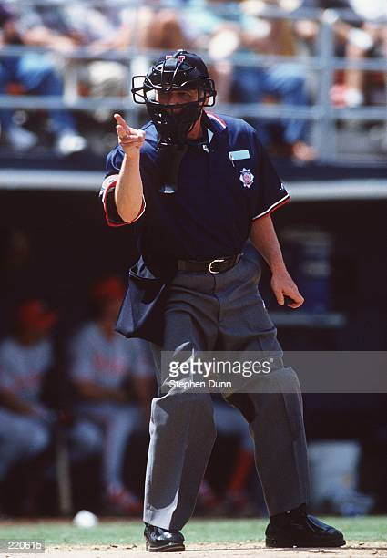 National League Umpire Terry Tata calls a strike during the San Diego Padres 7-5 win over the Philadelphia Phillies at Jack Murphy Stadium in San...