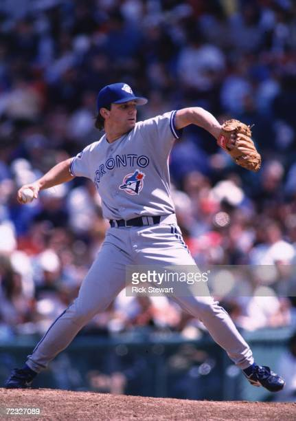 Pitcher Pat Hentgen of the Toronto Blue Jays winds up to throw a pitch during the Blue Jays 114 win over the Boston Red Sox at Fenway Park in Boston...
