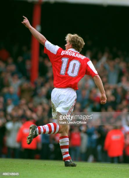 05 May 1996 Premiership Arsenal v Bolton Wanderers Dennis Bergkamp of Arsenal celebrates his goal and points to the crowd