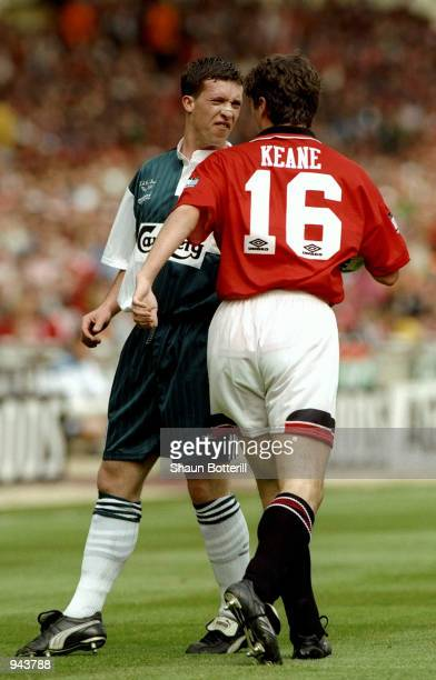 Robbie Fowler of Liverpool and Roy Keane of Manchester United exchange words during the FA Cup Final at Wembley Stadium in London Manchester United...