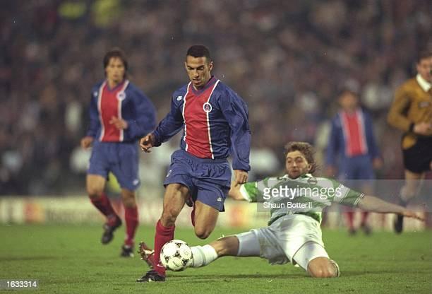Youri Djorkaeff of Paris St Germain gets away from Trifon Ivanov of Rapid Vienna during the European Cup Winners Cup final in Brussels Belgium Paris...