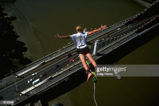 A bungee jumper plummets towards the ground during a jump at Chelsea Bridge in London England Mandatory Credit Craig Prentis /Allsport