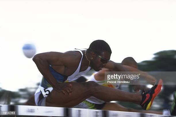 Allen Johnson of the USA leaps a hurdle during the 110 metre hurdles in the IAAF Grand Prix Series in Rio De Janeiro Brazil Johnson finished first in...