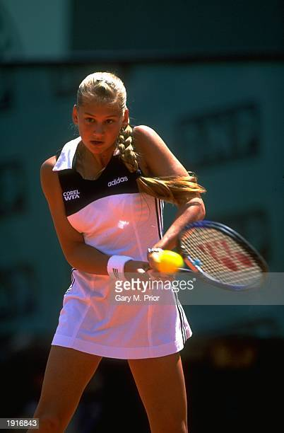 Anna Kournikova of Russia plays a backhand return during the French Open at Roland Garros in Paris Kournikova was knocked out in the third round by...