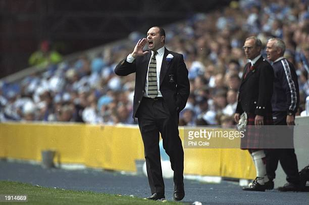 Bobby Williams the Kilmarnock manager shouts orders to his players during the Tennents Scottish FA Cup Final against Falkirk at Ibrox in Glasgow...