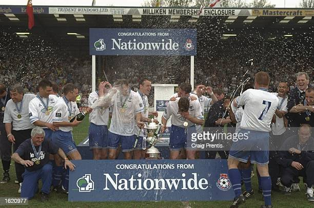 Bury celebrate winning the Nationwide Division Two Championship after the match against Millwall at Gigg Lane in Bury England Mandatory Credit Craig...