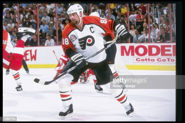 Center Eric Lindros of the Philadelphia Flyers moves down the ice during Game 1 of the Stanley Cup Finals against the Detroit Red Wings at the...