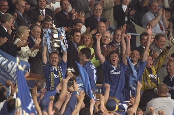 Dennis Wise , the Chelsea captain, holds the FA Cup aloft after victory in the FA Cup Final against Middlesbrough at Wembley Stadium in London,...