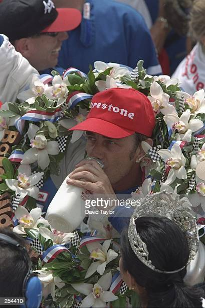 Driver Arie Luyendyk wears a flower wreath after winng the Indy 500 at the Indianapolis Speedway in Indianapolis Indiana
