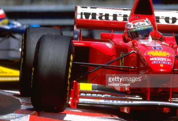 Eddie Irvine of Great Britain cuts close to a corner in his Scuderia Ferrari during the Monaco Grand Prix at the Monte Carlo circuit in Monaco...