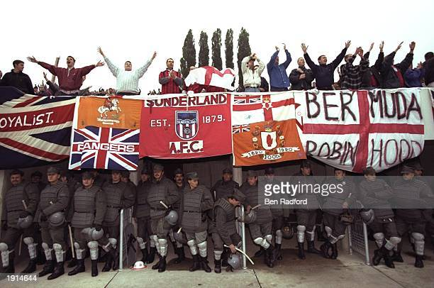 England fans chant songs above Polish security at the World Cup Qualifier between Poland and England at Chorzow Stadium in Katowice Poland England...